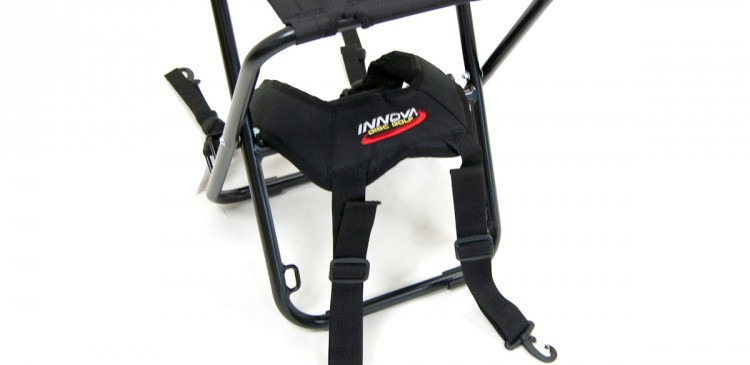 PART I: Place BackSaver Strap as shown with longer straps through and over the lumbar pad and middle support rod.
