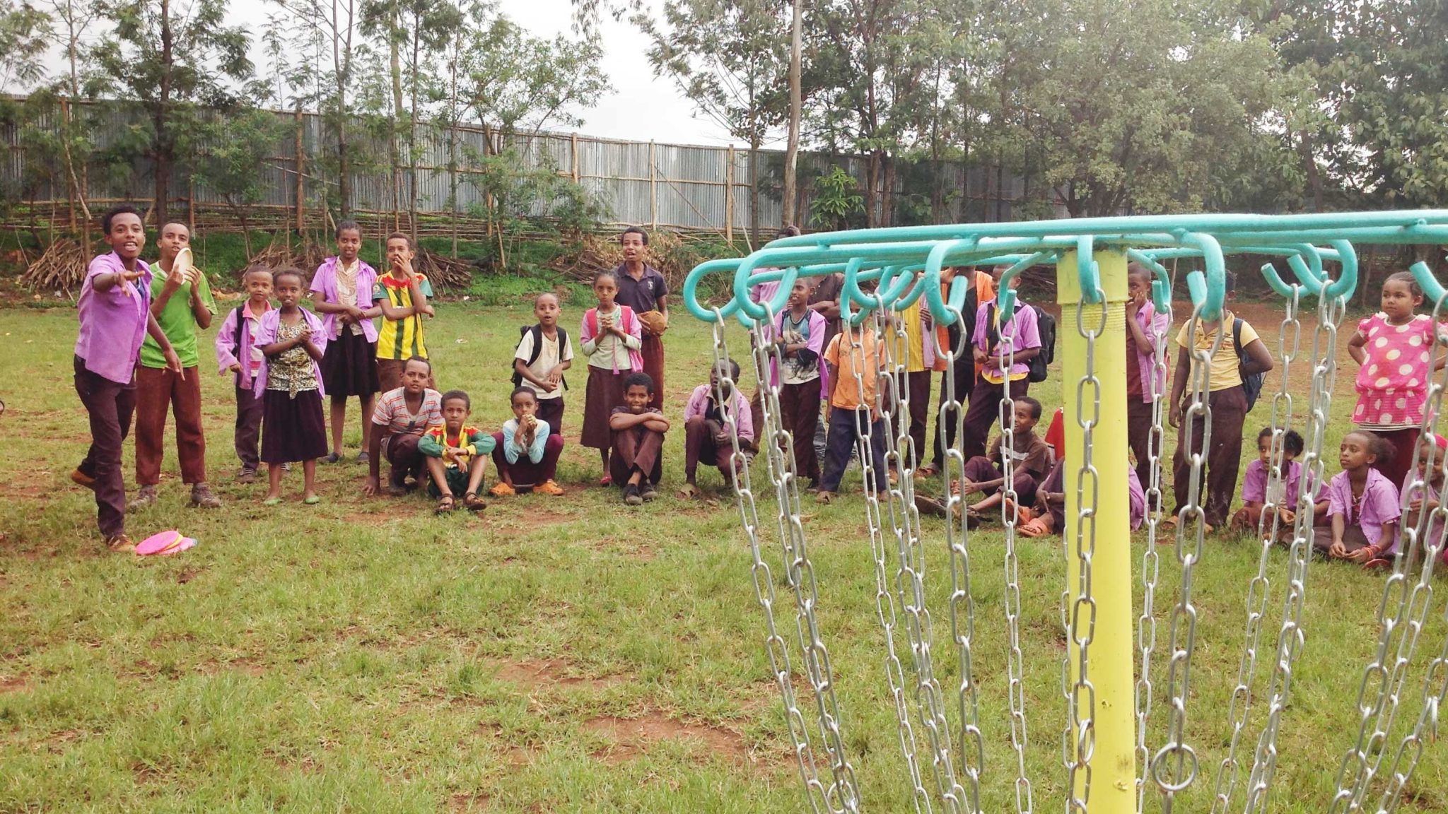 School children playing disc golf in AFrica